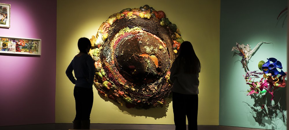 Students look at installation art inside the York College Galleries