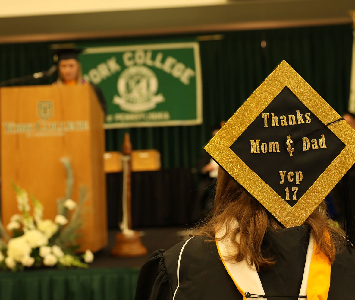 2017 YCP graduate looks on as fellow classmate addresses the Class of 2017.