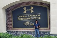 YCP student, Jonathan Marin, stands in front of the Baltimore Raven's training facility.