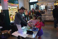 John Doherty works with students during First Friday event.
