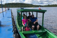 Graham Scholars travel by boat while traveling in Brazil.