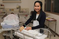 York College student Ileen Yeng poses for photo while suctioning infant mannequin.