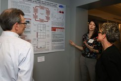 Student presents undergraduate research to faculty member.