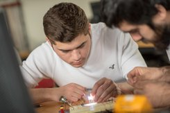 Electrical engineering students work hands-on in the classroom.
