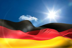 Stock photo of german flag flying on a sunny day.