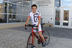 Onasis Bisbal prepares to ride his bike outside the Grumbacher Sport and Fitness Center.