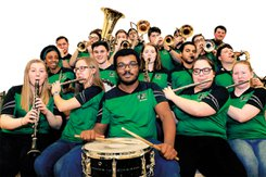 YC Pep Band stands as a group with their instruments.