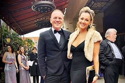 Miles Watson and a female actress pose for a photo on the red carpet.