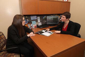 Amanda Rich meets with student in her office.