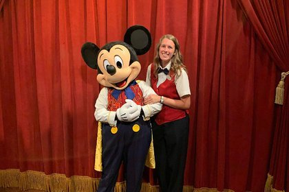 Sarah Crippen poses with Mickey Mouse at Disney World.