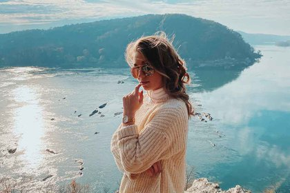 Hannah Maute is pictured in front of a lake and mountain with sunglasses