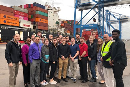Supply chain students pose at Port of Philadelphia on field trip.