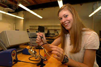 Mikayla Trost works on electrical engineering project in a lab in the Kinsley Engineering Center.