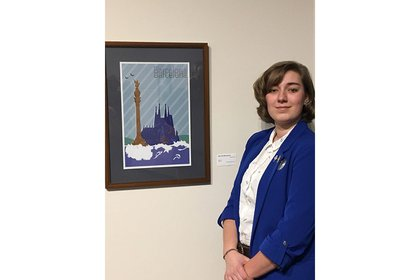 Ellen Korver stands with her artwork at Marketview Arts