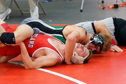 Greg Warner competes in a wrestling match at the in the NCAA Division III National Championship tournament.