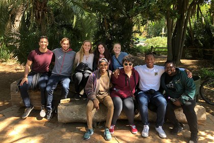 YCP student Jessika Roberts sits with students during study abroad experience