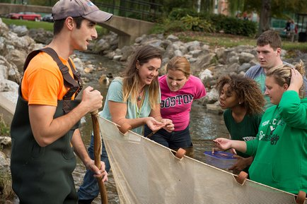 York College students getting hands-on learning in our creek.
