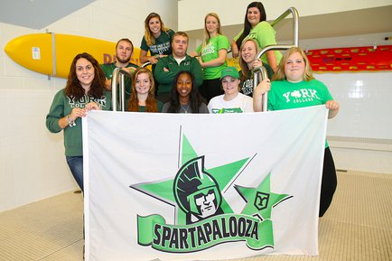 The Spartapalooza crew showing off the sign for the 2015 event, hosted by recreation and leisure students.