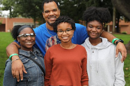 A family attends Fall Fest and Homecoming Weekend
