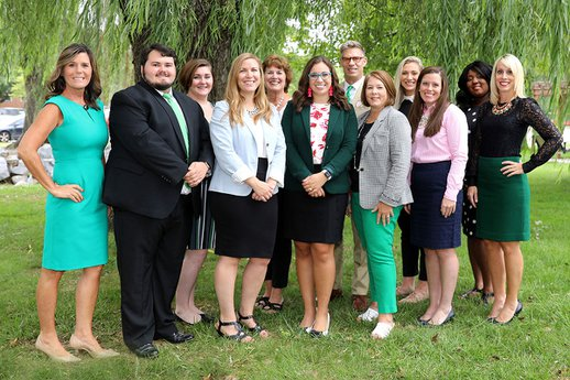 The York College Admissions Team stands for a photo under a willow tree on campus.