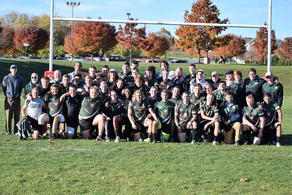 The York College Club Men's Rugby team stands on field as a group.