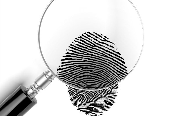 Stock photo of magnifying class magnifying a fingerprint.