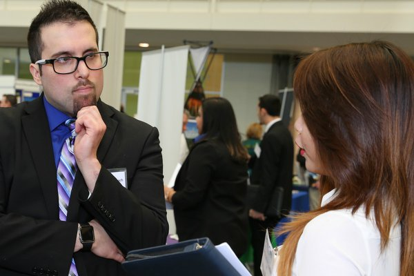Student interacts with employer at the Career Expo.