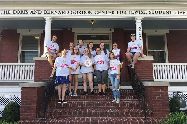 Students standing on steps of Gordon Center in doing good t-shirts