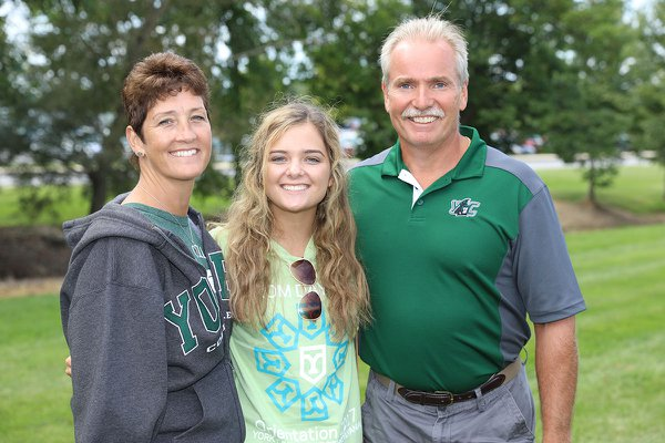 Student stands with her family during orientation weekend