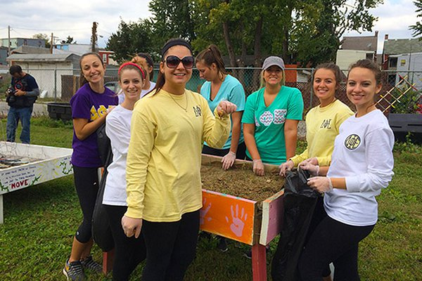 A group of Spartan help work on a community garden for Spartan Service Day 2015.