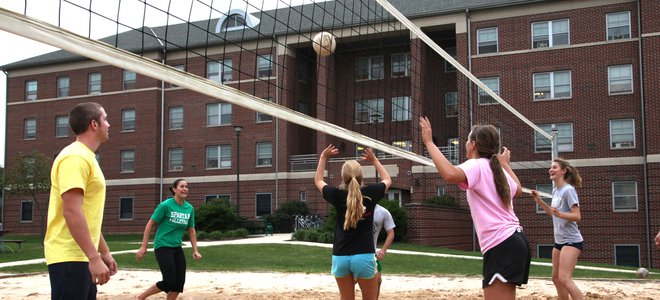 York students playing volleyball in the West Campus Little Run Lodge sand court