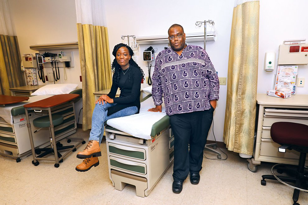Cathy Cooper and Dr. Fallah sit in simulation lab during Dr. Fallah's visit to campus.