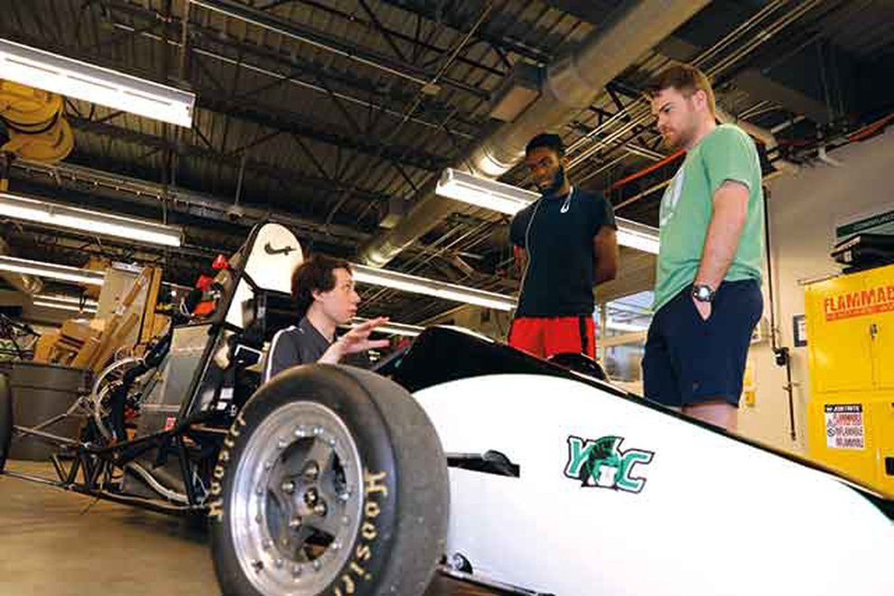 Students standing around YC go-cart