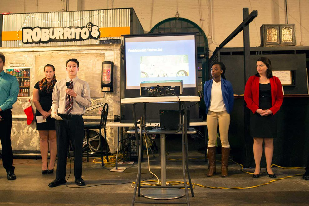 YC Magazine covers the Graham Scholars program at York College. Here, students present ideas for improving Central Market.