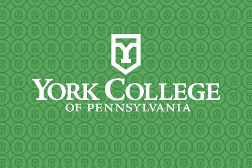 The York College Logo rests on a green background